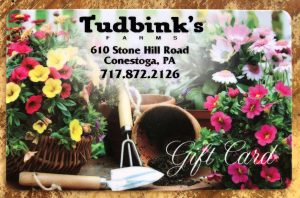 gift card with gardening equipment and flowers